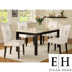 @Overstock - Add a stylish look to your dining room with this contemporary five-piece dining set from Mendoza. Featuring four white chairs upholstered in faux leather and an ebony and white rubberwood table, the set is perfect for small dinner gatherings. http://www.overstock.com/Home-Garden/ETHAN-HOME-Mendoza-5-piece-White-60-inch-Dining-Set/5274178/product.html?CID=214117 $799.99