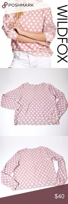 Wildfox Polka Dot Pink White Sweatshirt Large Wild fox dog baggy beach jumper. Love this sweatshirt, but I don't love how it fits me. My loss is your gain! Gently worn.  Soft pink with off white polka dots. Has a worn/pilling look, but that's the normal look and feel of the baggy beach jumper. So super soft, you'll want to wear it forever! Long sleeves, pullover style, flattering boat neckline. Good preloved condition. Wildfox Tops Sweatshirts & Hoodies