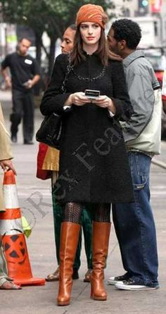 From the Devil Wears Prada: Black Knee Length Coat, Rebecca Taylor  Brown Boots, Christian Louboutin