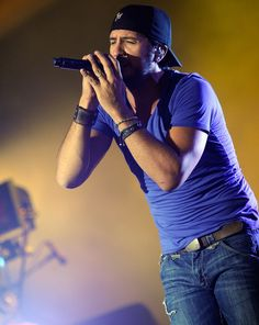 Luke Bryan.   You got your hands up  You're rocking in my truck  You got the radio on  You're singing every song  I'm set on cruise control  I'm slowly losing hold  Of everything I got  You're looking so damn hot