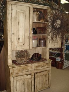 Old Distressed Cupboard...filled with old crocks...from Carolina Window Fashions, Fayetteville, NC Antiques.