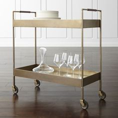Shop Libations Bar Cart.  Store your bar tools, barware and booze on a vintage bar cart from Crate and Barrel.  The Libations bar cart is a top seller and works with any style.