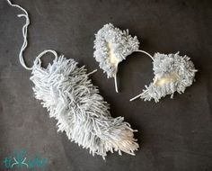 Learn how to make a wolf or dog tail out of yarn with this incredibly easy tutorial. All you need is yarn, and nothing else! It& fabulous for a quick and easy Halloween costume, or just creative dramatic play. Dog Ears Costume, Toddler Dog Costume, Dog Costumes For Kids, Wolf Costume, Diy Dog Costumes, Animal Costumes, Costume Ideas, Dalmatian Costume, Grease Costumes