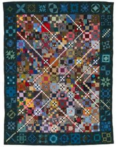 Trail Mix Mania meets Dear Jane. This quilter blended two very different, complex, and popular quilt patterns. Talk about a pieced border!