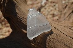 Authentic frosted beach sea glass necklace wire wrapped on a sterling silver box chain. The sea glass is real clear frosted beach glass. The…