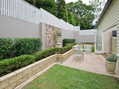 Landscaped garden design using grass with retaining wall & cubby house - Gardens photo 331210