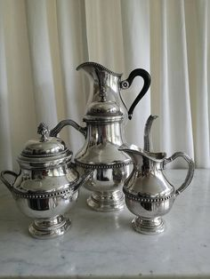 Check out this item in my Etsy shop https://www.etsy.com/listing/583744800/antique-silver-plate-tea-coffee-set