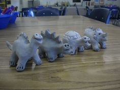 clay dinosaurs Clay Art Projects, Ceramics Projects, Ceramic Monsters, Clay Pinch Pots, Pottery Lessons, Woodland Art, We Will Rock You, Dinosaur Art, Art Sculpture