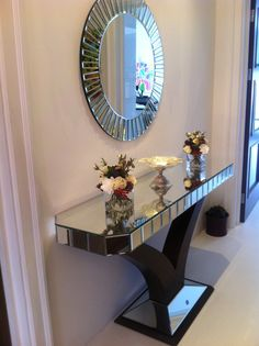 Our best selling Quartz Console and Mirror Set look stunning in Ms Hussain's hallway. Get yours here: http://shrops-design.co.uk/products/quartz-black-mirrored-console-table-mirror-set