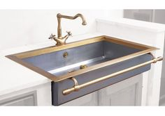 "Apron front Sink with towel bar in satin stainless steel and burnished  brass. Extra thick Stainless steel walls (2 mm). Bowl dimensions (inside) :  length 30 7/8"" width 18 1/8"", 6 5/8"" depth (785x460x168MM) Cut-out size  dimensions : length 31 1/2"" width *15 3/4"" *suggested (800x400MM)   Other dimensions can be custom made to order."