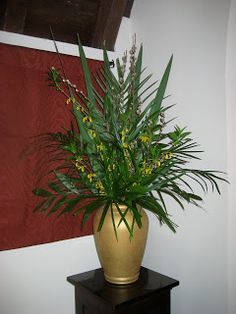 A touch of forsythia and pussywillow added into the palms gives a glimpse of what is to come!