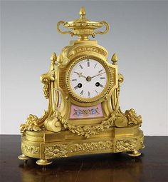 A 19th century French ormolu and porcelain mantel clock, 11i
