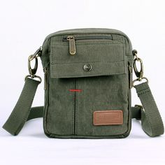 Dark green and Khaki small canvas messenger bag  $98.00