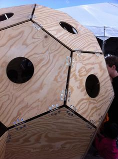 """Make a hinged wooden truncated icosahedron - A giant wooden soccer ball - that kids can climb in!  Paint it to reinforce the soccer ball connection for the """"uninformed""""."""