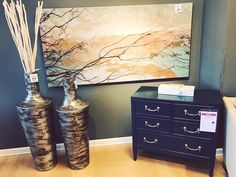 Have an empty wall space?  Fill 'er up w/ tall vases large wall decor & a chest!  |  Search Teal Chest on steinhafels.com |  #interiorinspiration #interiordesign #decorinspiration #homedecor #accessories #showroomdesign #foryourhome #walldecor #steinhafels #waukesha #wisconsin #relax