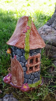 Check out this item in my Etsy shop https://www.etsy.com/listing/236946701/handmade-pottery-fairy-house-for-garden