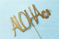 Check out this item in my Etsy shop https://www.etsy.com/listing/268499893/aloha-gold-glitter-cake-topper-bridal