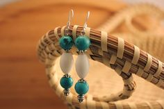 Add a pop of color to your outfit. Turquoise, white glass, and silver floral bead caps on surgical steel ear wires. Handmade Beaded Jewelry, Bead Caps, Wearable Art, Color Pop, Dangle Earrings, Dangles, Chokers, Beaded Bracelets, Turquoise