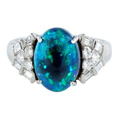 Black opal and diamond estate ring at www.66mint.com.