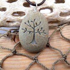Tree of Life - Nature's Mother necklace - All Natural engraved Beach Stone Pendant with top drilled Bail  Ask a Question $24.99 USD. USA