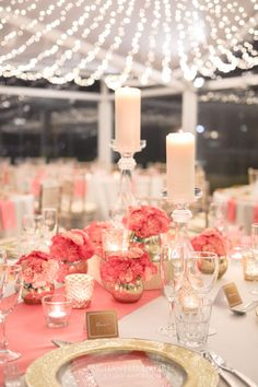 This beautiful coral and gold wedding, under a canopy of fairy lights, tables set with gold rimmed glass charger plates, coral runners and napkins. Glass candlesticks and coral florals in gold crackle mercury vases. Our vintage gold elevations added height to the table. The addition of soft candlelight was added with soft gold mercury tealight votives. The look was complete with custom menus, placecards and directional signage…