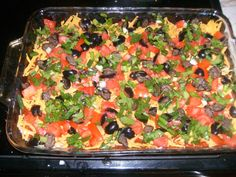 This recipe boasts more than traditional 7 layer Mexican dip. Added ingredients such as onion, cilantro, and ground beef,make this dish even tastier. Great for any holiday or ever day meals!