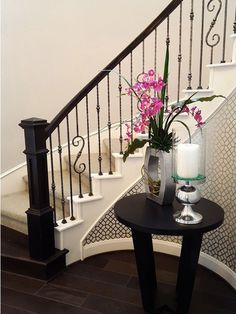 This design was created using Tuscan round forged balusters. The double sphere baluster (2.10.3), the single sphere baluster (2.10.2), and the spiraled scroll baluster (2.10.4) create a uniquely designed staircase. These components are available in Satin Black (shown), Copper Vein, Oil Rubbed Bronze, Satin Clear, and Vintage Brass. We offer parts, install services, and custom components throughout Texas. Click the image for more information.