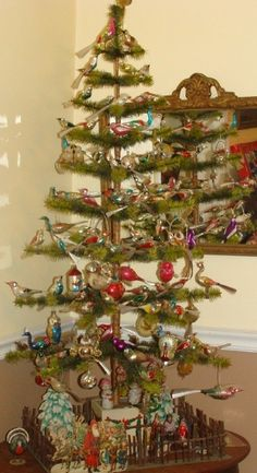 Feather Christmas tree, all decked out in vintage ornaments.