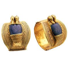 Solid gold bracelets set with lapis lazuli forming the central body of a goose, which has two heads and a tail worked in gold.