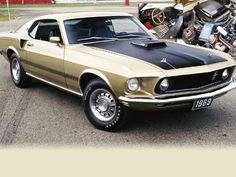 Image from https://image.adam.automotive.com/f/9789058/mump_0408_08_z+1969_ford_mustang_mach_1+gold_front_view.jpg.