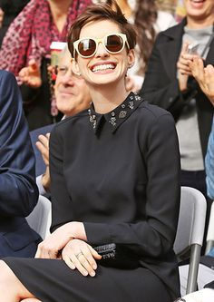 Anne Hathaway showed off some sweet Karen Walker shades and an even sweeter smile at the Hollywood Walk of Fame, where her Les Miserables co-star Hugh Jackman was honored Dec. 13