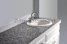 Google Image Result for http://www.stratastones.net/images/gallery/grey-flat-pebble-tile-bathroom-vanity.jpg