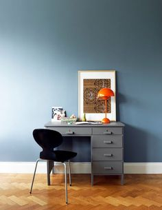 love this wall color, especially with the pop of orange from the lamp