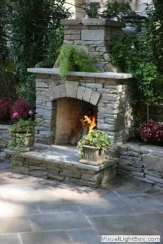 sandstone in landscaping   Landscaping natural stone outdoor fireplace with stone wall and ...