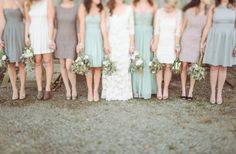 Bridesmaids mix it up with dresses in shade of mint, mauve, and gray. Sensational!