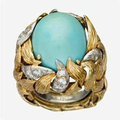 A turquoise, diamond, platinum and eighteen karat gold ring, David Webb  centering an oval cabochon turquoise accented by single and full-cut diamonds; total diamond weight approximately: 1.10 carats; signed Webb.