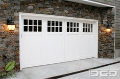 This custom carriage house style garage door is definitely the formal example of. - This custom carriage house style garage door is definitely the formal example of how well-made carr - White Garage Doors, Double Garage Door, Carriage House Garage Doors, Custom Garage Doors, Garage Door Windows, Garage Door Styles, Wood Garage Doors, Carriage Doors, Garage Door Design