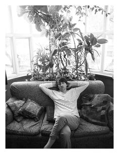 Love this! (the couch and the plants, not the dude)