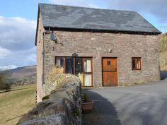 Mawr Well Cottage in Crickhowell, Wales. This pretty stone farmhouse sleeps 4 from £260 for the week.