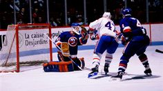 1990: Glenn Healy makes 51 saves for his second NHL shutout in the New York Islanders' 3-0 victory against the Vancouver Canucks at Nassau Coliseum. At the time, it's the second-highest number of saves in a shutout by an NHL goaltender, trailing only a 52-save shutout by Jacques Plante of the Montreal Canadiens against the Blackhawks at Chicago Stadium on Nov. 13, 1955.