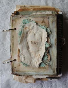 Love-puffed stitched heart-remember all those inserts from the jewelry boxes...we will be using some of those!