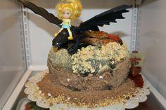 http://www.doregosbakery.com/train_your_dragon_cake_1.jpg
