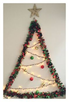 Lighting up Christmas trees is an age-old tradition. Outdoor Christmas lights decorations will help you to make your home beautiful. Wall Christmas Tree, Office Christmas, Simple Christmas, Xmas Tree, All Things Christmas, Christmas Wreaths, Christmas Crafts, Christmas Ornaments, Navidad Simple