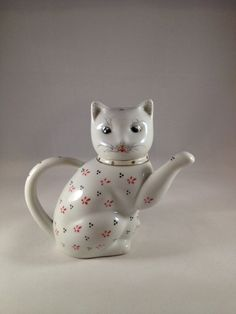 I have this one - Cute Vintage Cat Teapot by CuriousCatUK on Etsy, £7.00