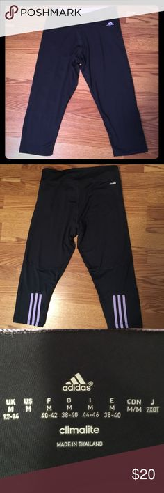 Adidas Climalite Capri pants Navy blue pants with lavender color stripes and inner waist band. ***sizing chart included in product photos*** adidas Pants Capris