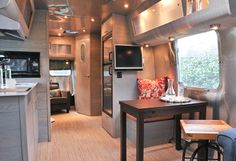 Contemporary dining room in a vintage Airstream trailer by Good Cottage