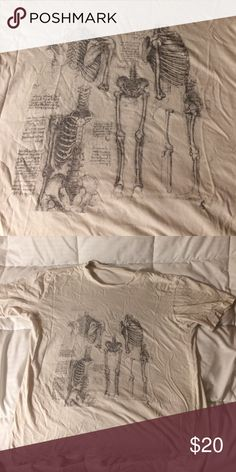 Anatomy tee No flaws and in good condition, has an off-white almost beige-like color. Could fit a small or medium.⭐️ Brandy Melville Tops Tees - Short Sleeve