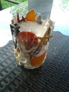 Handmade candle with sea shells