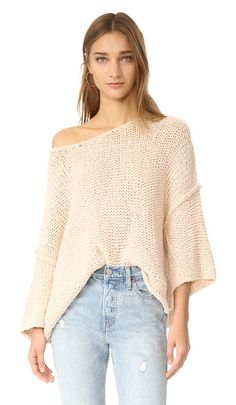 halo pullover by Free People. A playfully proportioned Free People sweater with a relaxed fit. Loose sleeves. Scoop neckline. Fabric: Open knit. 80...