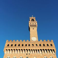 Palazzo Vecchio standing in front of a blue screen